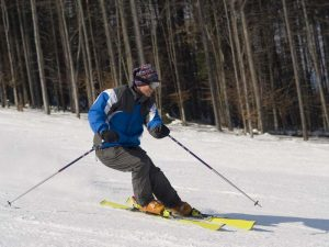 Man a skier rides on a slope downward